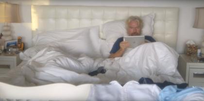 Branson reading ipad