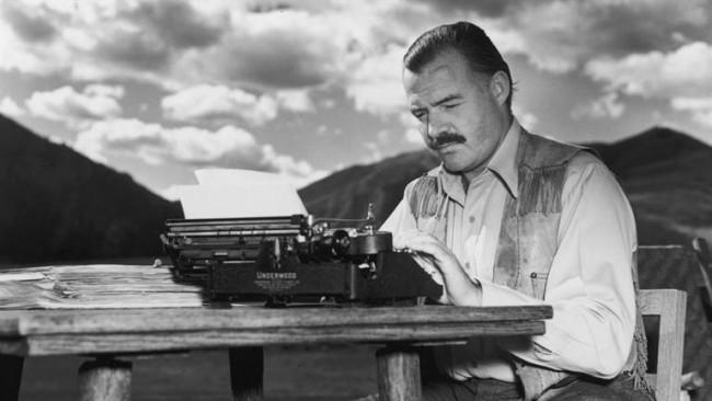 hemingway-at-his-typewriter-e1460840960422
